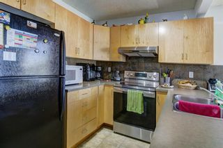 Photo 7: 388 Panatella Boulevard NW in Calgary: Panorama Hills Row/Townhouse for sale : MLS®# A1114400