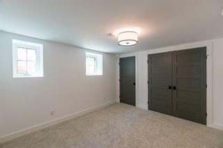 Photo 42: 322 Kelvin Boulevard in Winnipeg: River Heights / Tuxedo / Linden Woods Residential for sale (South Winnipeg)  : MLS®# 1615915