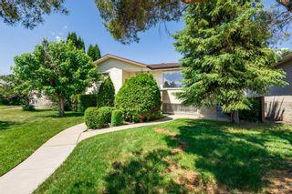 Photo 2: 10126/10128 133 Avenue in Edmonton: Zone 01 House Duplex for sale : MLS®# E4251495
