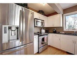 Photo 7: 98 Patina Rise SW in CALGARY: Prominence_Patterson Townhouse for sale (Calgary)  : MLS®# C3591171