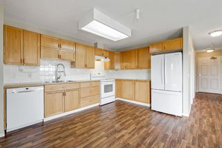 Photo 6: 301 305 1 Avenue NW: Airdrie Apartment for sale : MLS®# A1134588