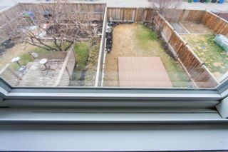 Photo 23: 1413 Ranchlands Road NW in Calgary: Ranchlands Row/Townhouse for sale : MLS®# A1133329