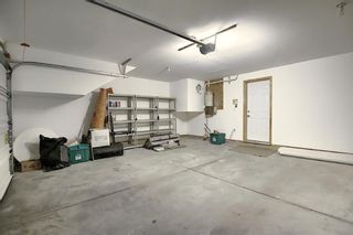Photo 35: 25 Tuscany Springs Gardens NW in Calgary: Tuscany Row/Townhouse for sale : MLS®# A1053153