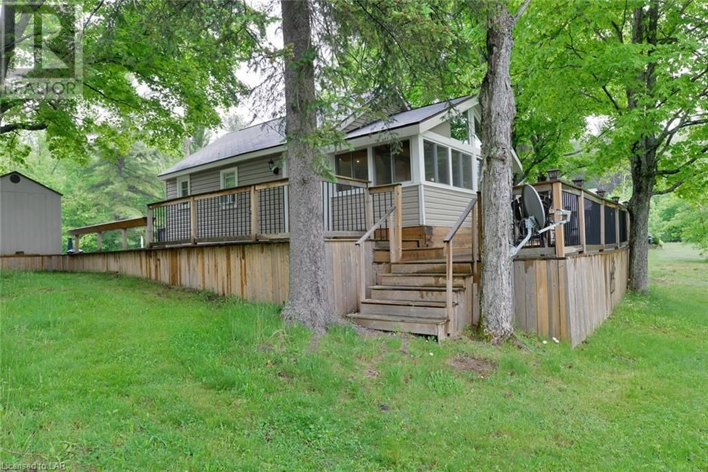 Main Photo: 1168 MOON RIVER Road Unit# Cottage 4 in Bala: House for sale : MLS®# 40124965