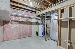 Photo 32: 128 Rainbow falls Grove E: Chestermere Duplex for sale : MLS®# A1154026