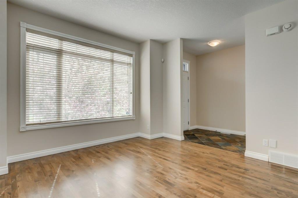 Main Photo: 4111 Garrison Boulevard SW in Calgary: Garrison Woods Row/Townhouse for sale : MLS®# A1108505