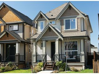 "Photo 1: 7317 194A Street in Surrey: Clayton House for sale in ""Clayton Village"" (Cloverdale)  : MLS®# F1311061"