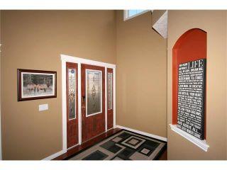 Photo 3: 52 BOW RIDGE Drive: Cochrane House for sale : MLS®# C4066881