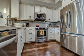 Photo 7: 101 830 2 Avenue NW in Calgary: Sunnyside Row/Townhouse for sale : MLS®# A1150753