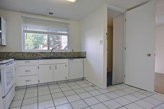 Photo 8: 835 Forest Place SE in Calgary: Forest Heights Detached for sale : MLS®# A1120545