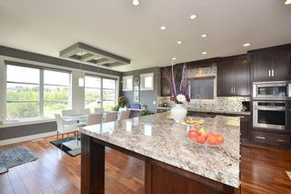 Photo 12: 697 TUSCANY SPRINGS Boulevard NW in Calgary: Tuscany Detached for sale : MLS®# A1060488