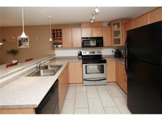 Photo 2: 102 3142 ST JOHNS Street in Port Moody: Port Moody Centre Condo for sale : MLS®# V930148