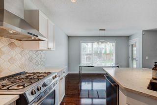 Photo 11: 572 Cougar Ridge Drive SW in Calgary: Cougar Ridge Detached for sale : MLS®# A1143842