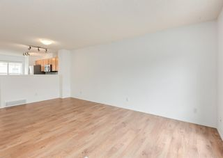 Photo 4: 311 Toscana Gardens NW in Calgary: Tuscany Row/Townhouse for sale : MLS®# A1133126