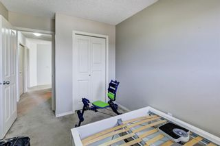 Photo 20: 388 Panatella Boulevard NW in Calgary: Panorama Hills Row/Townhouse for sale : MLS®# A1114400