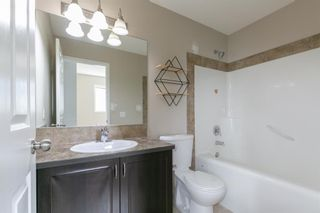 Photo 16: 58 Arbours Circle NW: Langdon Row/Townhouse for sale : MLS®# A1137898