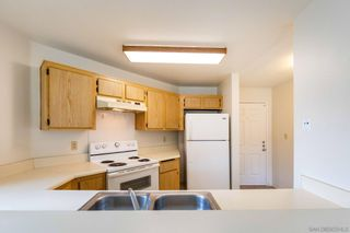 Photo 7: SAN DIEGO Condo for sale : 1 bedrooms : 7405 Charmant Dr #2310