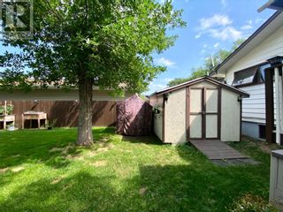 Photo 6: 415 3A Street W in Brooks: House for sale : MLS®# A1129371