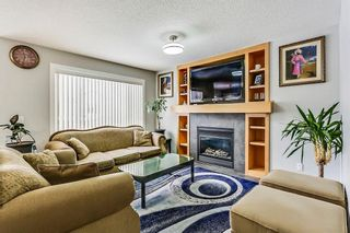 Photo 16: 325 Saddlecrest Way NE in Calgary: Saddle Ridge House  : MLS®# C4149874