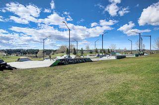 Photo 41: 226 Quigley Drive: Cochrane Semi Detached for sale : MLS®# A1107845