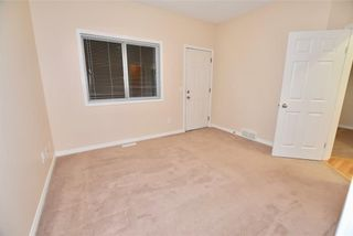 Photo 10: 746 Carriage Lane Drive: Carstairs House for sale : MLS®# C4165692