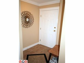 "Photo 2: 310 15268 105TH Avenue in Surrey: Guildford Condo for sale in ""GEORGIAN GARDENS"" (North Surrey)  : MLS®# F1121659"