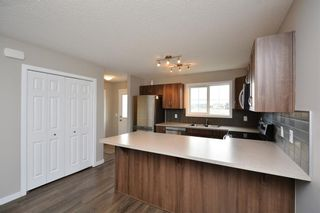 Photo 10: 52 SUNSET Road: Cochrane House for sale : MLS®# C4124887