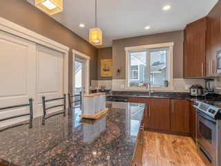 Photo 18: 43 WEST SPRINGS Lane SW in Calgary: West Springs Row/Townhouse for sale : MLS®# C4256287