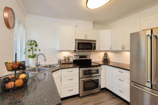 """Photo 5: 405 13900 HYLAND Road in Surrey: East Newton Townhouse for sale in """"HYLAND GROVE"""" : MLS®# R2605860"""
