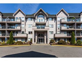 "Photo 1: 305 33738 KING Road in Abbotsford: Poplar Condo for sale in ""College Park"" : MLS®# R2303950"