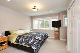 """Photo 12: 101 3333 DEWDNEY TRUNK Road in Port Moody: Port Moody Centre Townhouse for sale in """"CENTREPOINT"""" : MLS®# R2378597"""
