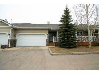 Photo 1: 2 117 BOW RIDGE Drive: Cochrane House for sale : MLS®# C4003118
