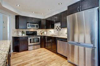 Photo 9: 212 Coachway Lane SW in Calgary: Coach Hill Row/Townhouse for sale : MLS®# A1153091