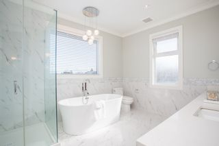 Photo 17: 10700 HOLLYBANK Drive in Richmond: Steveston North House for sale : MLS®# R2562038