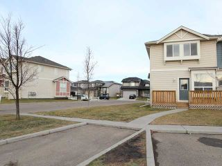 Photo 2: 301 703 LUXSTONE Square: Airdrie Townhouse for sale : MLS®# C3642504