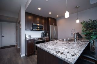 """Photo 7: 301 2238 WHATCOM Road in Abbotsford: Abbotsford East Condo for sale in """"WATERLEAF"""" : MLS®# R2492483"""