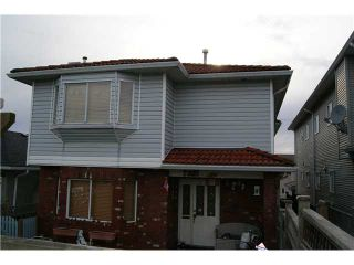 Photo 1: 7327 FRASER Street in Vancouver: South Vancouver 1/2 Duplex for sale (Vancouver East)  : MLS®# V843279