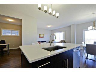 Photo 4: 140 FIRESIDE Place: Cochrane House for sale : MLS®# C4004650