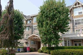 "Photo 1: 316 960 LYNN VALLEY Road in North Vancouver: Lynn Valley Condo for sale in ""Balmoral House"" : MLS®# R2562644"