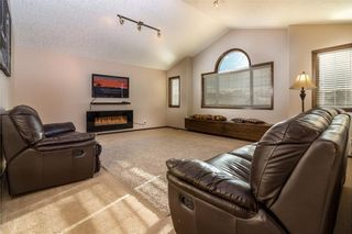 Photo 9: 30 WEST POINTE Manor: Cochrane House for sale : MLS®# C4150247