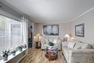 Photo 7: 787 Kingsmere Crescent SW in Calgary: Kingsland Row/Townhouse for sale : MLS®# A1108605