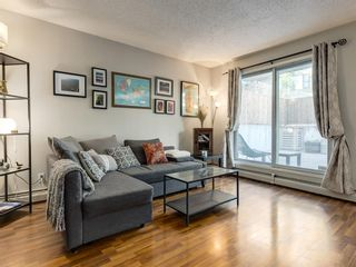 Photo 2: 102 1721 13 Street SW in Calgary: Lower Mount Royal Apartment for sale : MLS®# A1086615