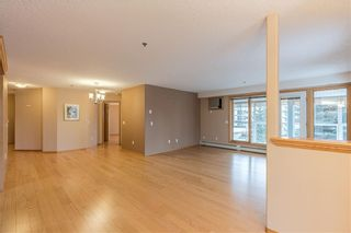 Photo 3: 214 7239 SIERRA MORENA Boulevard SW in Calgary: Signal Hill Apartment for sale : MLS®# C4282554