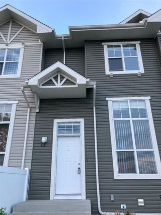 Photo 2: 119 Toscana Gardens NW in Calgary: Tuscany Row/Townhouse for sale : MLS®# A1121039
