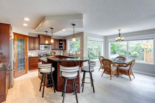 Photo 7: 63 Springbluff Boulevard SW in Calgary: Springbank Hill Detached for sale : MLS®# A1131940