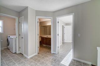 Photo 18: 4 136 Bow Ridge Drive: Cochrane Row/Townhouse for sale : MLS®# A1116097