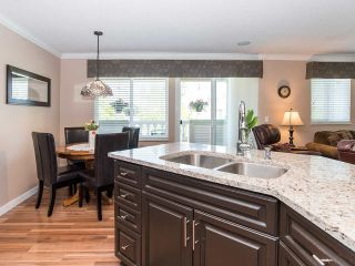 """Photo 4: 116 13888 70TH Avenue in Surrey: East Newton Townhouse for sale in """"Chelsea Gardens"""" : MLS®# R2400447"""
