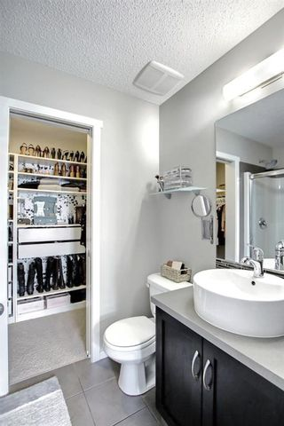 Photo 26: 1103 125 Panatella Way NW in Calgary: Panorama Hills Row/Townhouse for sale : MLS®# A1143179