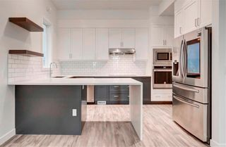 Photo 5: 2 137 24 Avenue NE in Calgary: Tuxedo Park Row/Townhouse for sale : MLS®# C4278414