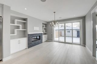 Photo 4: 835 21 Avenue NW in Calgary: Mount Pleasant Semi Detached for sale : MLS®# A1056279